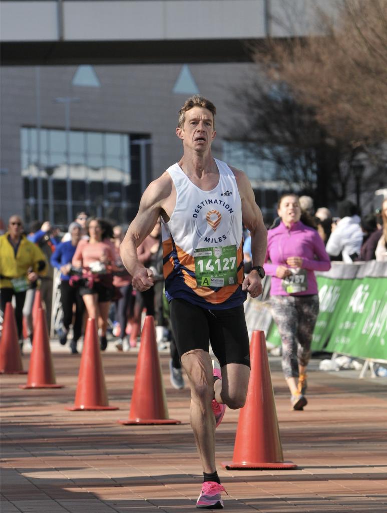 Matt Fitzgerald running angrily in a marathon