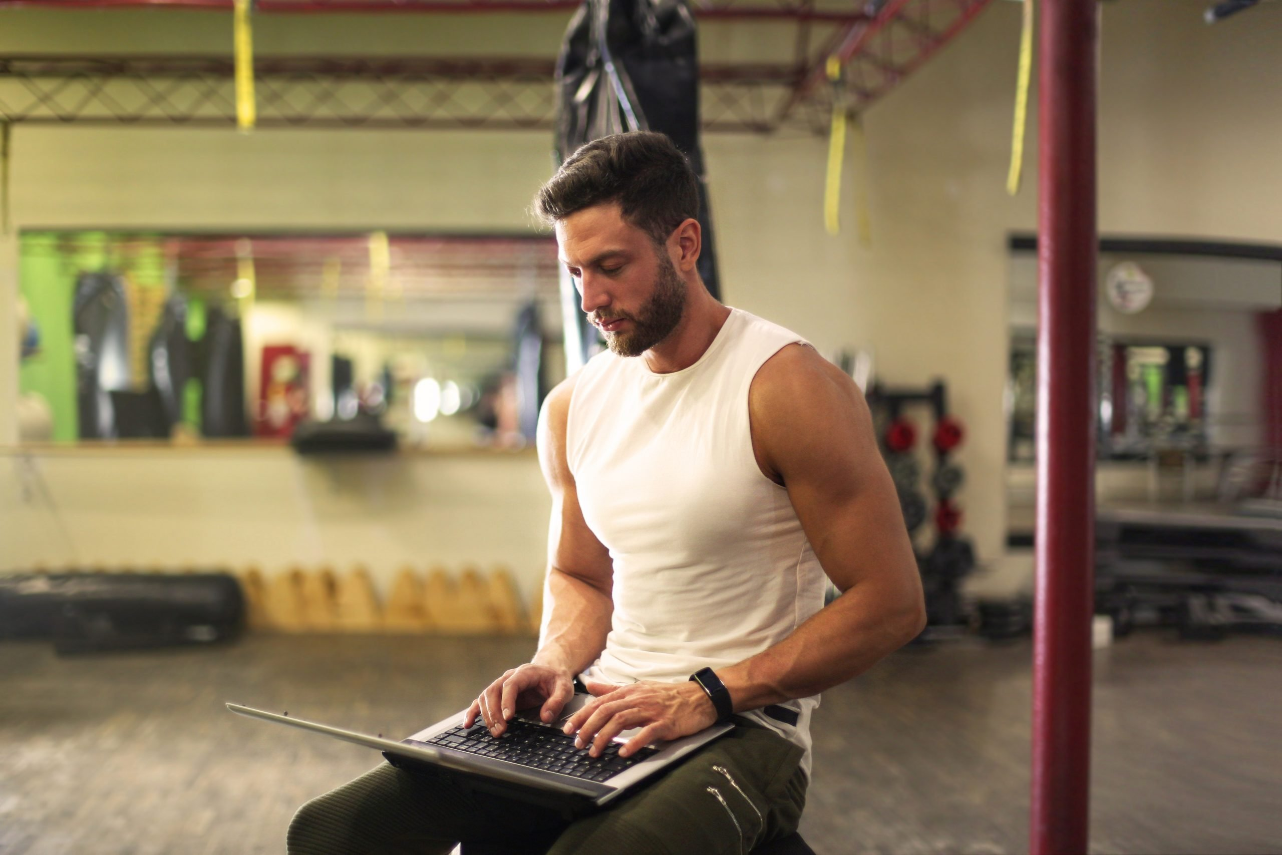 Fit man using a laptop